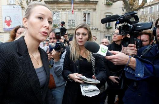 Marion Marechal-Le Pen, French National Front political party member and candidate for National Front in the Provence-Alpes-Cote d'Azur (PACA) region is surrounded by media as she leaves the polling station after casting her ballot during the first round of the regional elections in Carpentras, France, December 6, 2015. REUTERS/Jean-Paul Pelissier